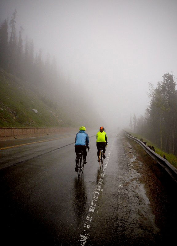 Cyclists make their way up a wet Berthoud Pass in 2011. The rain quickly changed to snow that year, making for a cold, slow trek to the top of the Pass.