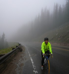 A very wet cyclist makes his way up Berthoud Pass during a rain-snow storm in 2011.