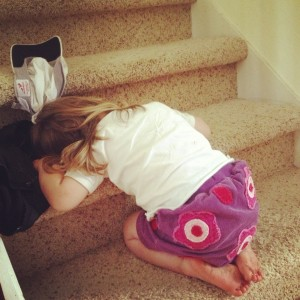 After awaking from her nap, she proceeded to fall back asleep on the stairs.